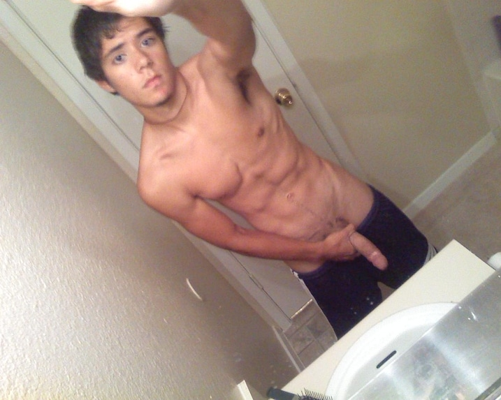 Muscled Guy Playing With His Dick In Front Of The Mirror