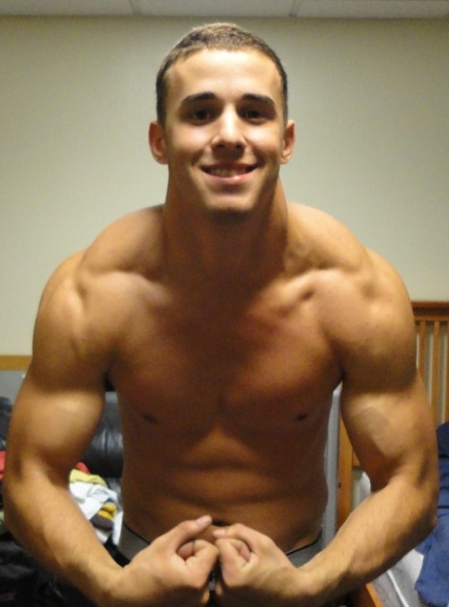 Muscle Boy Flexing For The Camera